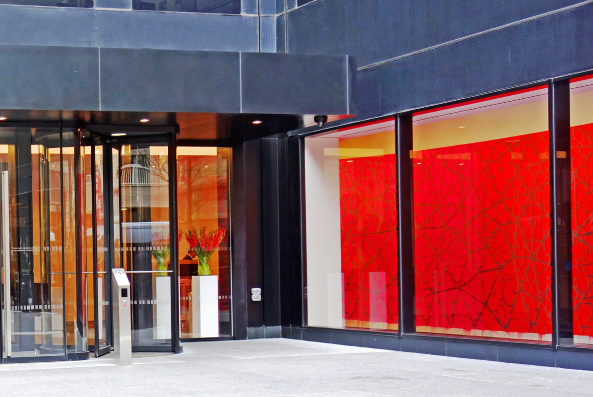 Bloomberg Custom Storefront With Revolving Doors + Custom Entrance Doors.