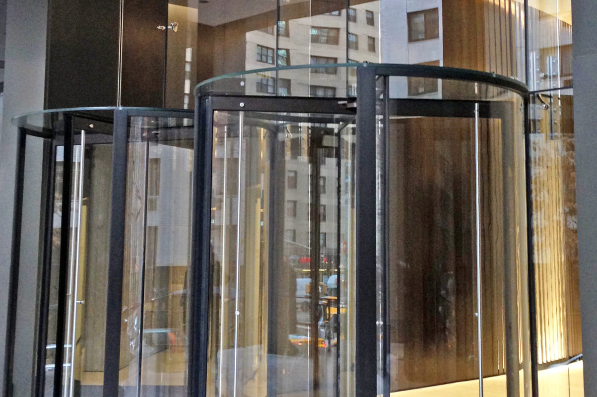 All Glass Revolving Door + Structural Glass Storefront.