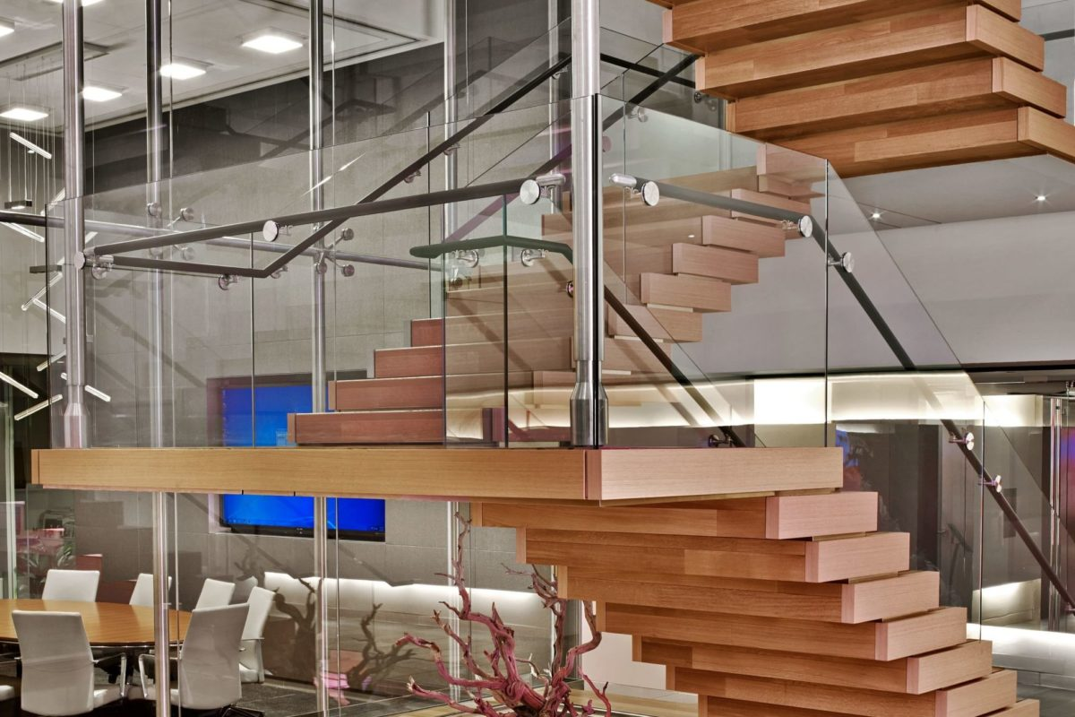 Leather Wrapped Handrail + Glass Guard Railing Integrated In Wood Clad Stair.
