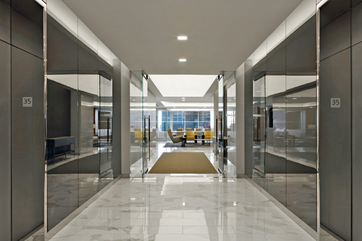Mirror Finish Stainless Steel Elevator Door Portals + Back Painted Glass.