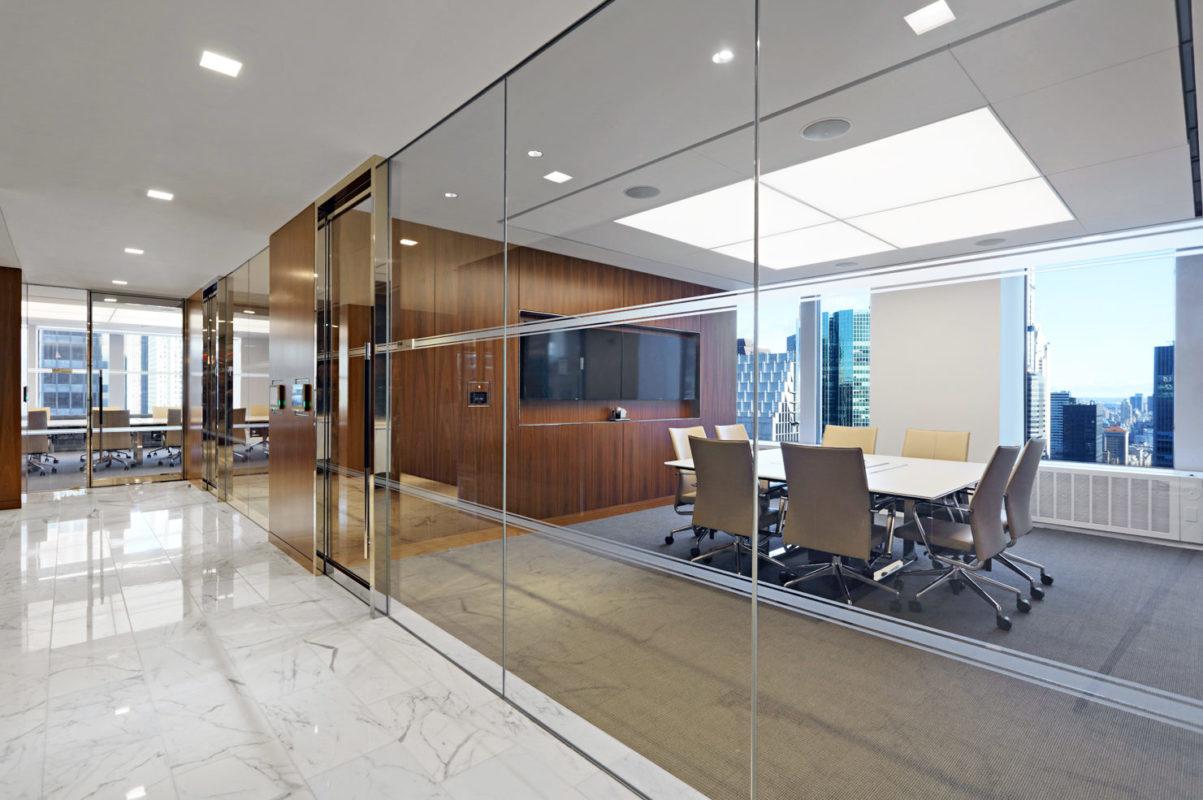 Mirror Finish Stainless Steel Door Portals + Glass Office Fronts.