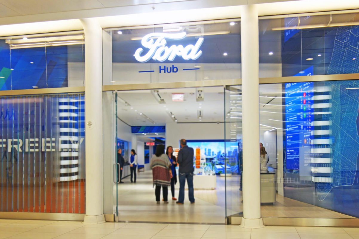 Design Built Ford Experience Store With Custom Laminated Glass With Printed Interlayer Throughout.