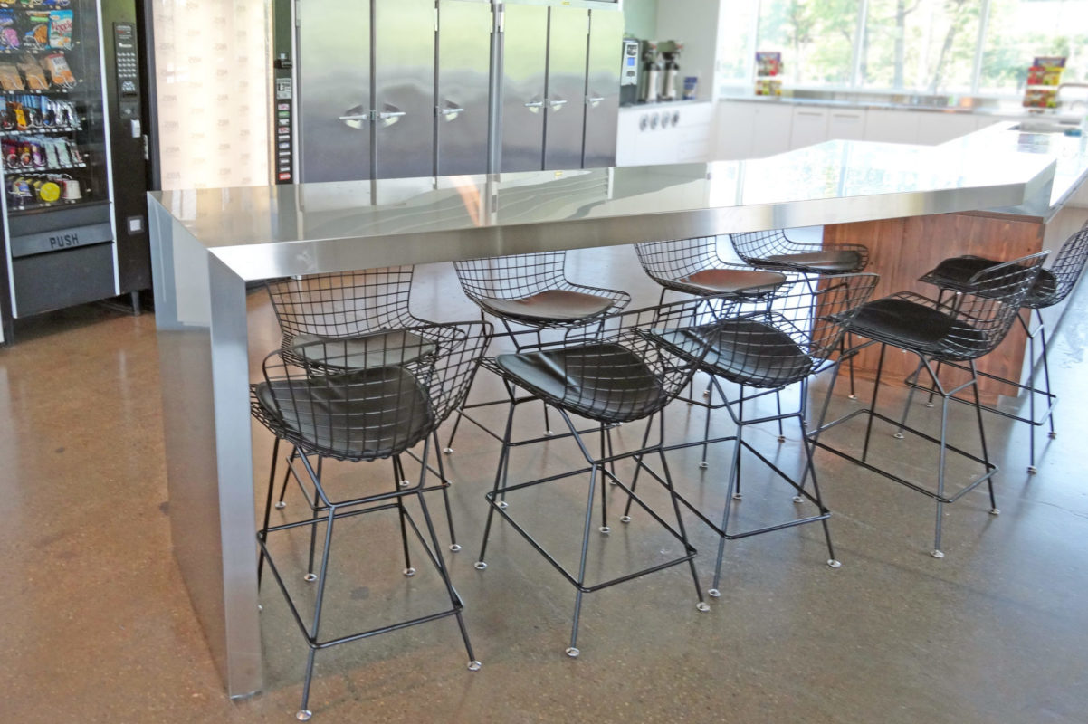 Stainless Steel Clad Communal Tables.