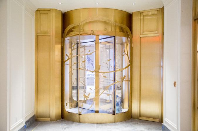 Custom Bronze Revolving Door.