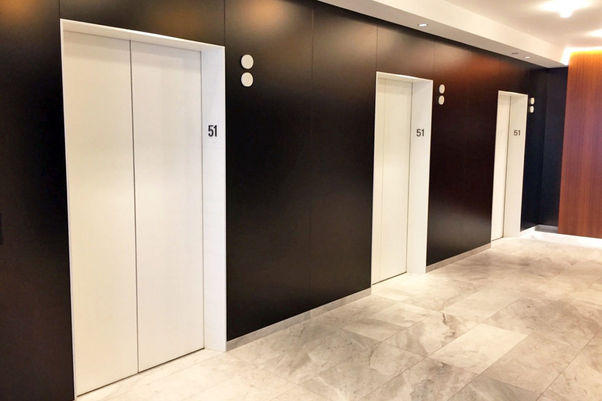 Powder Coated Steel Elevator Portals + Satin Etched Back Painted Glass.