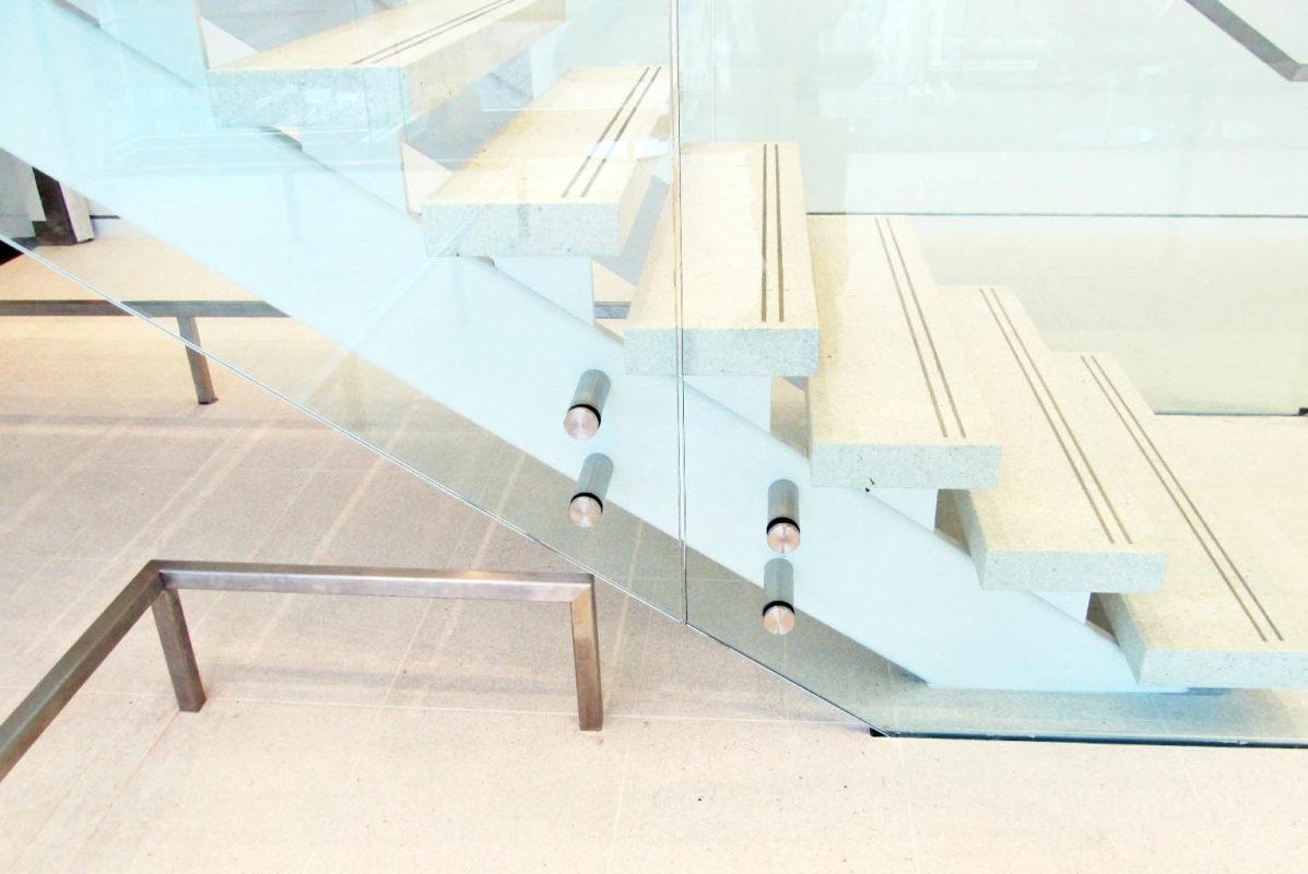 Painted Structural Steel Stair, Glass Guardrails, + Custom Standoffs.