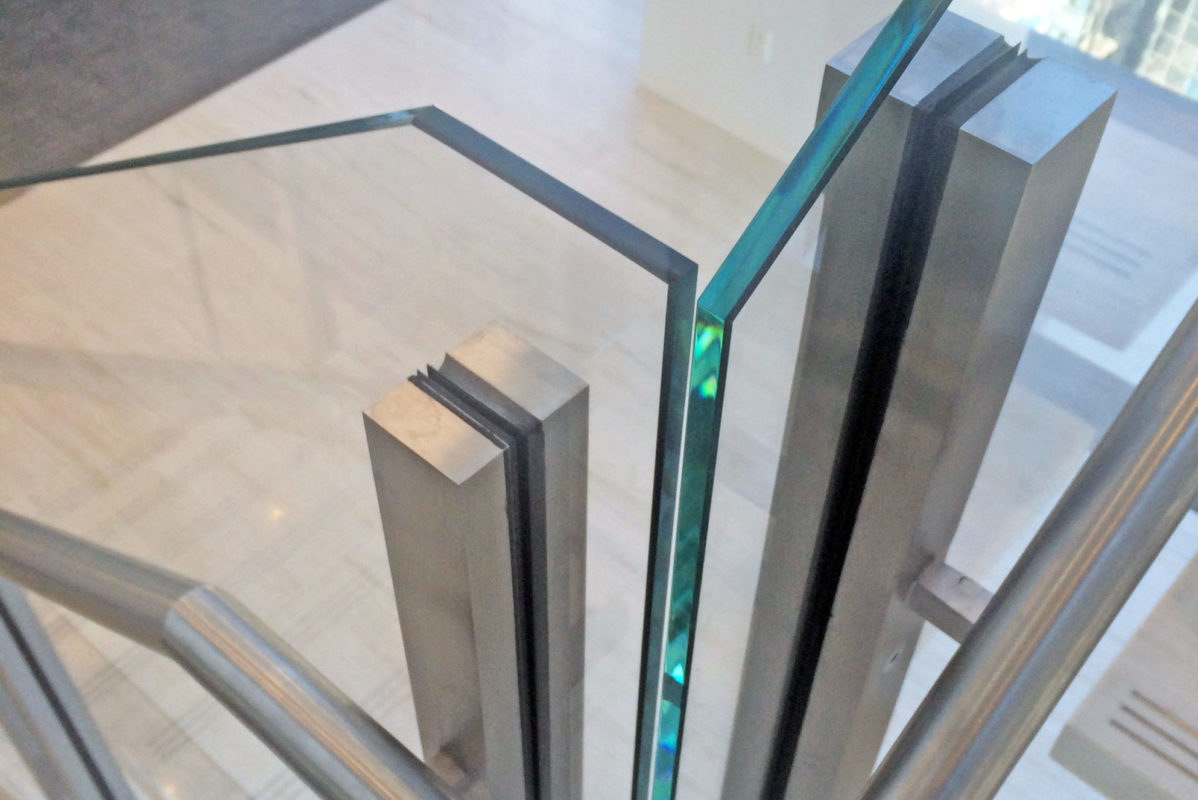 Custom Stainless Steel Post Glass Guardrail + Stainless Steel Clad Structural Stringers.