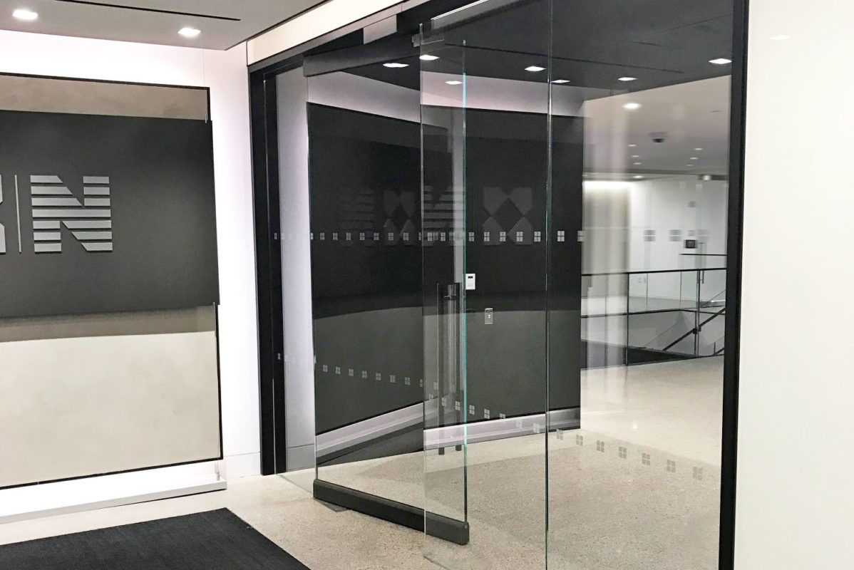 Custom Entrance In Newmark Grubb Knight & Frank Office Space.