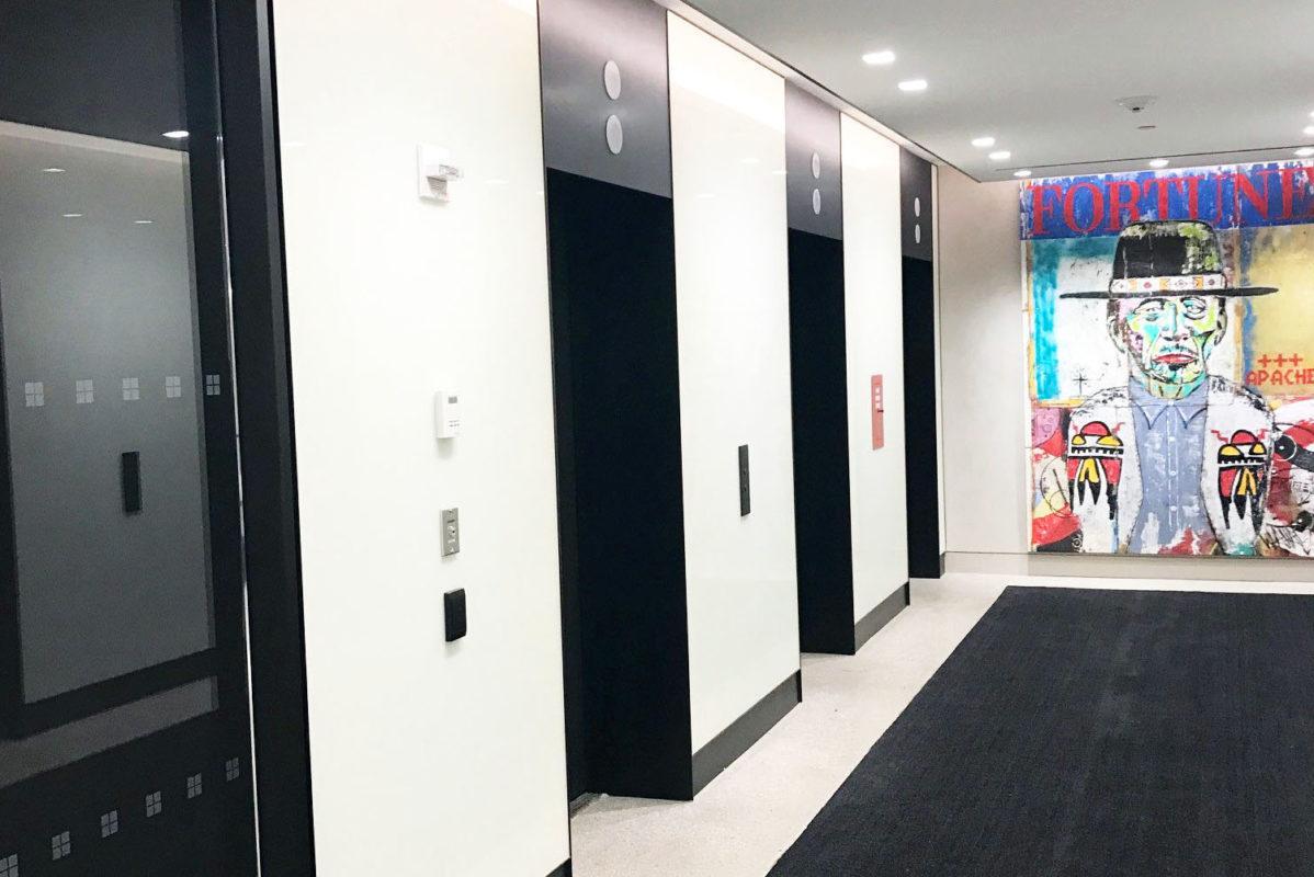 Custom Blackened Steel Elevator Portals & Header + Back Painted Glass.