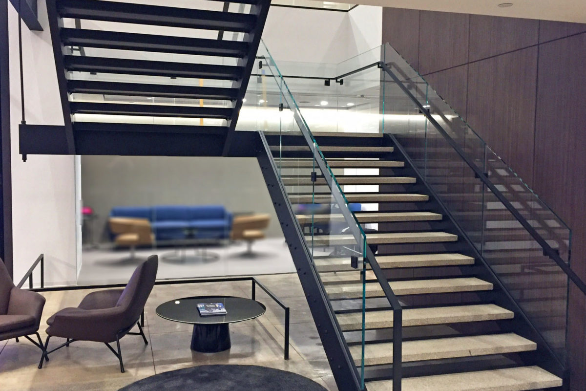 Custom Design Build Stair Fabricated By Mistral With Blackened Steel Supports, Glass Railing, + Hand Rails.