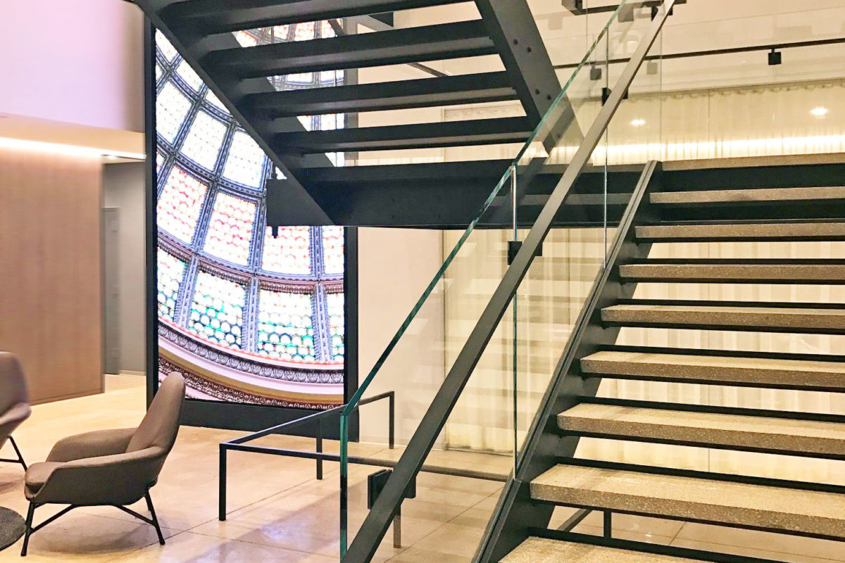 Custom Design Build Stair Fabricated By Mistral With Blackened Steel Tread Supports + Bolted Connections For An Industrial Look.