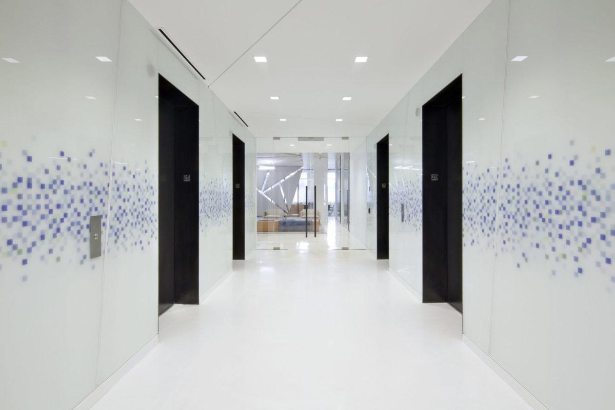 Custom Blackened Steel Elevator Portals + Custom Pattern Back Painted Glass.