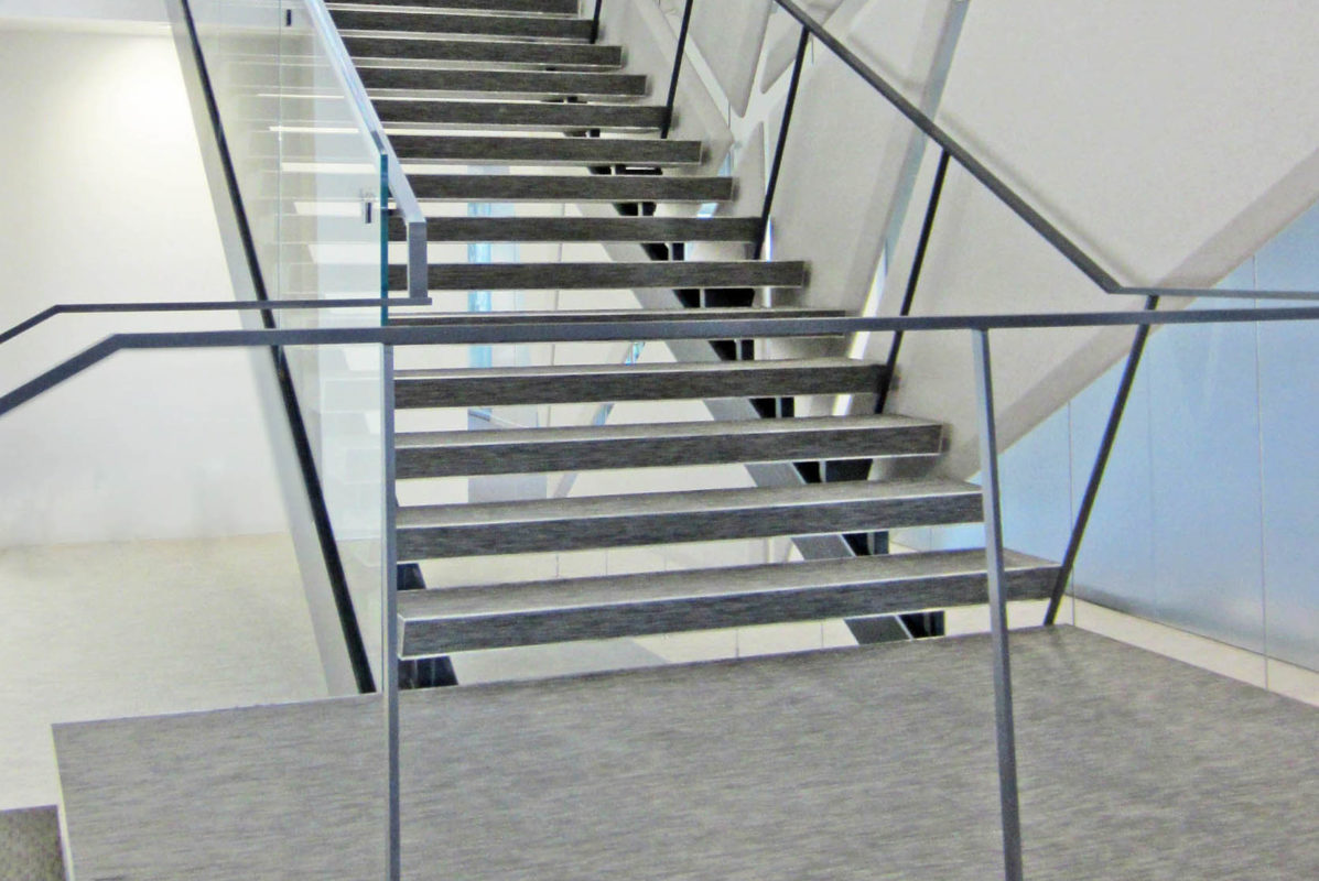 Custom Steel + Glass Staircase With Stainless Steel Framed Treads And Landing.