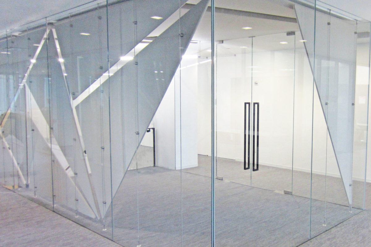 Custom Glass Office Front, Stainless Steel Cable System To Hold Fabric Panels.