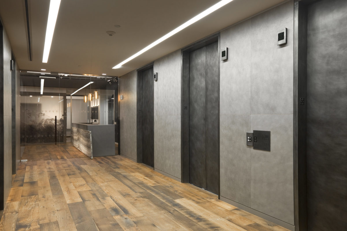 Custom Oxidized Zinc Cladded Elevator Doors + Portals, + All Glass Entrance.