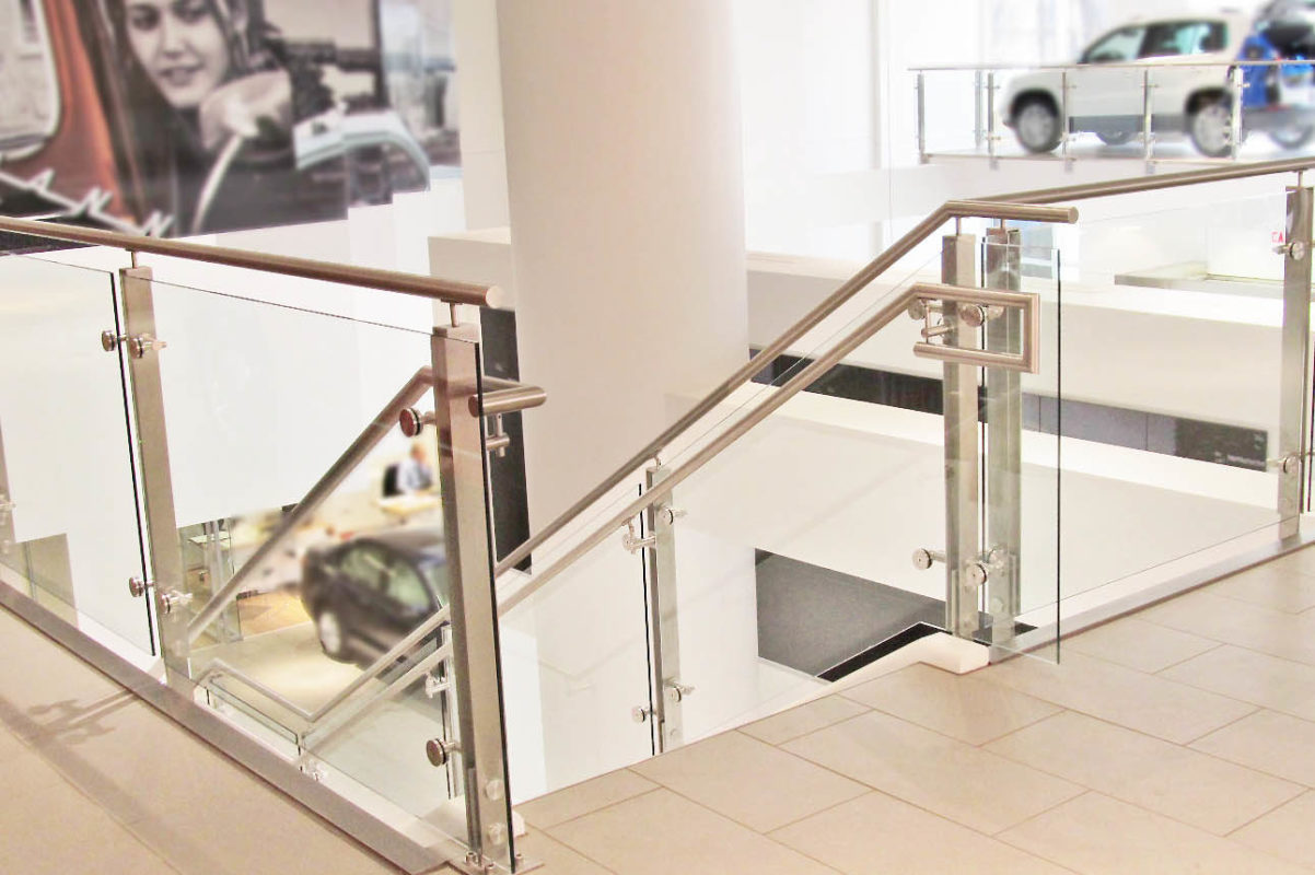 Custom Stainless Steel Post + Glass Guard Railing.
