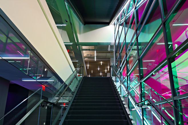 Custom Laminated Glass Guardrail System With Blackened Steel Handrail.