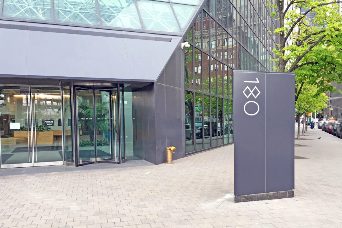 Stainless Steel Revolving Doors + ADA Entrance Doors.