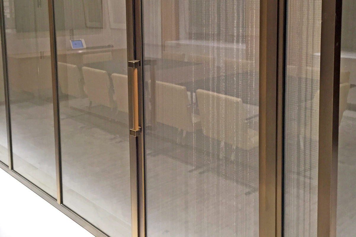 Custom Bronze Frame Conference Room With Glass Panels + Metal Mesh Interlayer.Angelo Gordon – 245 Park Avenue – New York, NYRobert A.M. Stern Architects