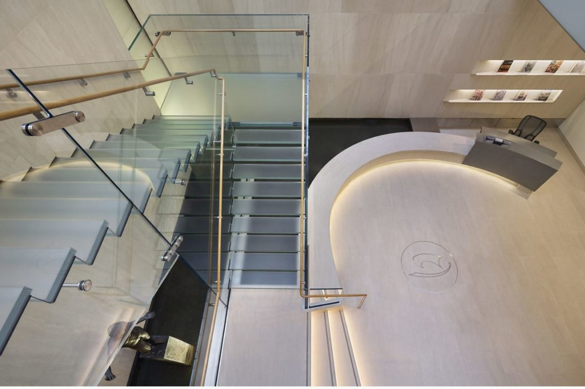 Glass Stair Over Water Feature.