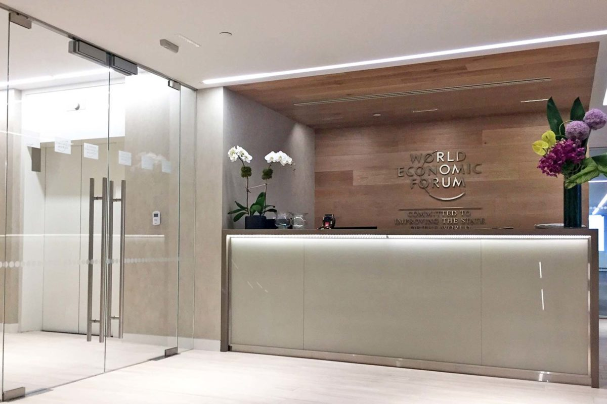 Ultra-Clear Glass Entrance Doors, Back Painted Glass, + Stainless Steel Base On Reception Desk.