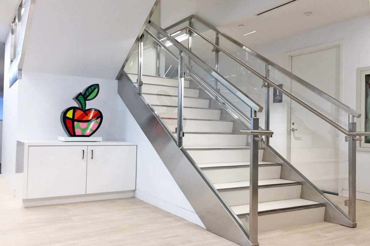 Retro-fit Of Existing Stair With Stainless Steel + Glass Railing System + Custom Cladding Of Stringer.