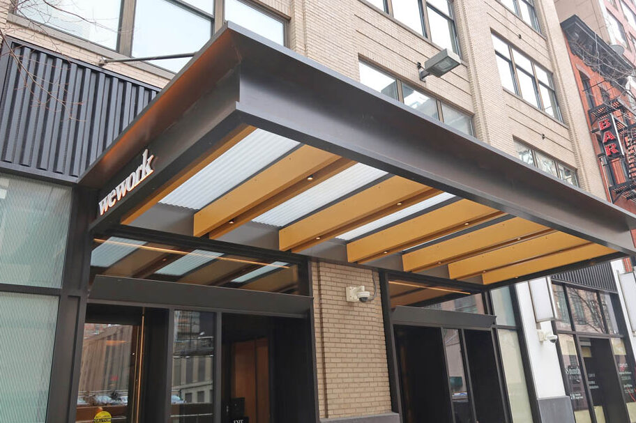 Custom Fabricated Canopy With Corrugated Glass + Faux Wood Finish.TH Real Estate 368 9th Avenue - New York, NYArchitect: Gensler
