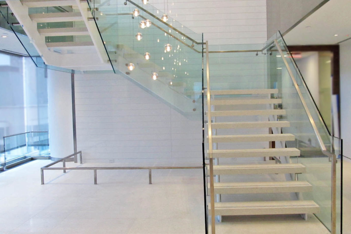 Design Build Stair With Painted Finish + Side Mounted Glass Guard Railing.Man Group - 4 West 40th Street – New York, NY Architect: Axls Design Group International, LLC