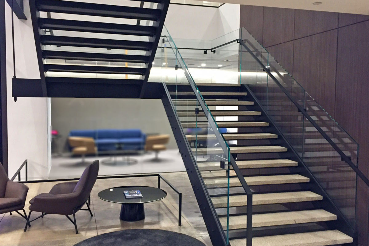 Custom Design-Build Stair Fabricated By Mistral With Blackened Steel Supports, Glass Railing, + Hand Rails.Newmark - 125 Park Avenue – New York, NY Architect: Gensler