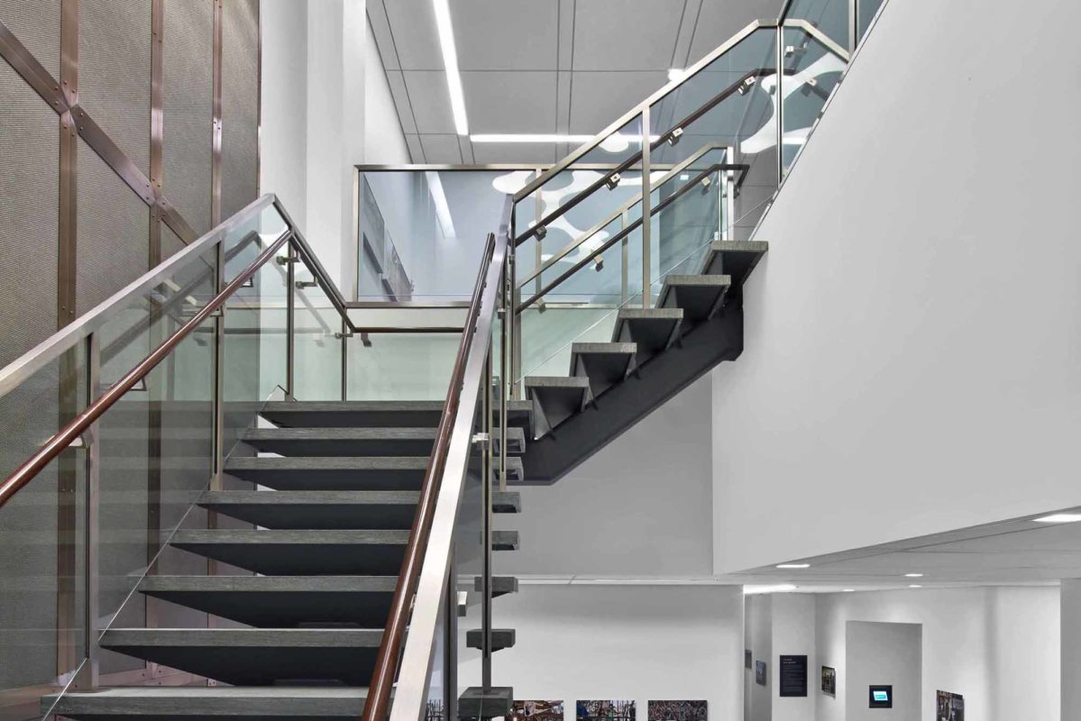 Custom Stainless Steel + Glass Staircase, + Bronze Framed Architectural Stainless Steel Mesh.OSI - 224 West 57th Street – New York, NY Architect: HLW International LLP
