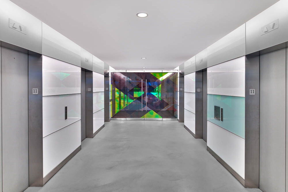 Custom Stainless Steel Portals And Base + Back Painted Glass. Viacom New York, NY Architect: MdeAs Architects