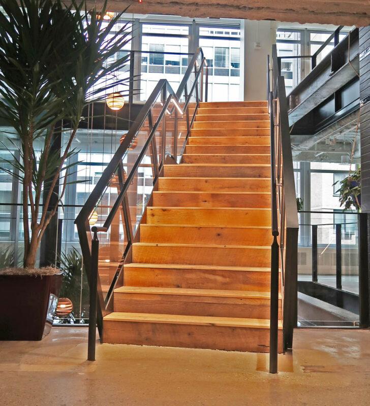 Custom Laminated Glass Guardrails + Handrail.EisnerAmper 733 3rd Avenue - New York, NY Architect: Francis Cauffman Architects