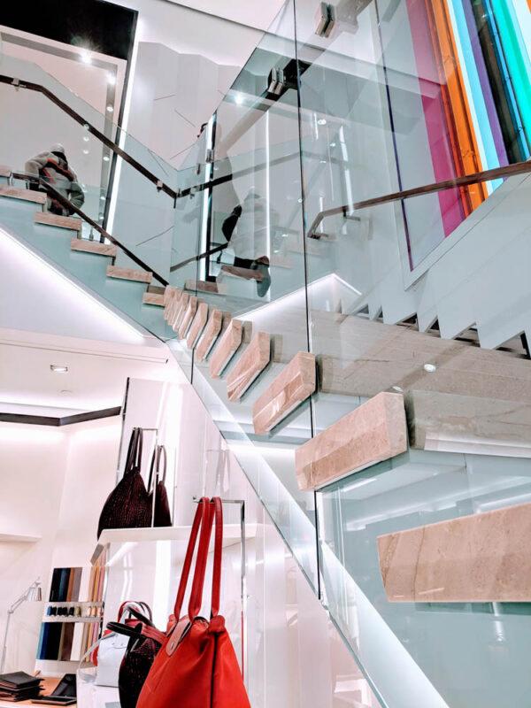 Custom Laminated Glass Guardrails + Handrail.Longchamp 645 5th Ave - New York, NY Architect:  CallisonRTKL