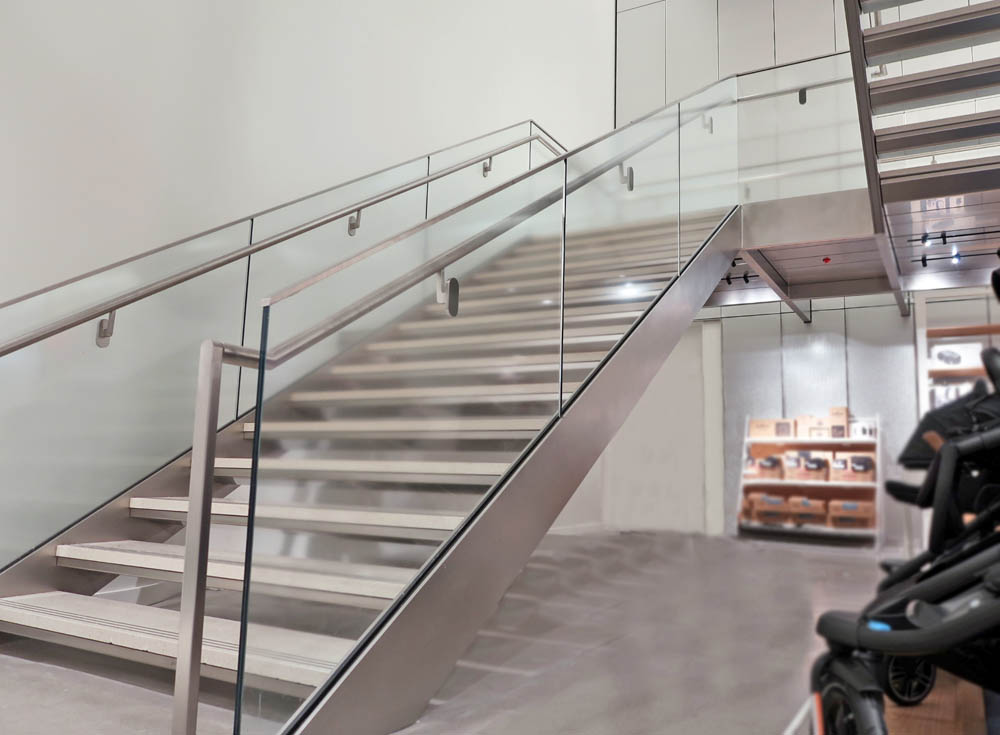 Custom Laminated Glass Guardrails + Handrail.Nordstrom Flagship 1790 Broadway - New York, NY Architect: CallisonRTKL