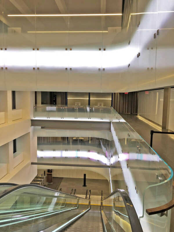 Custom Oversized Fritted Flat + Curved Glass Panels In Atrium.