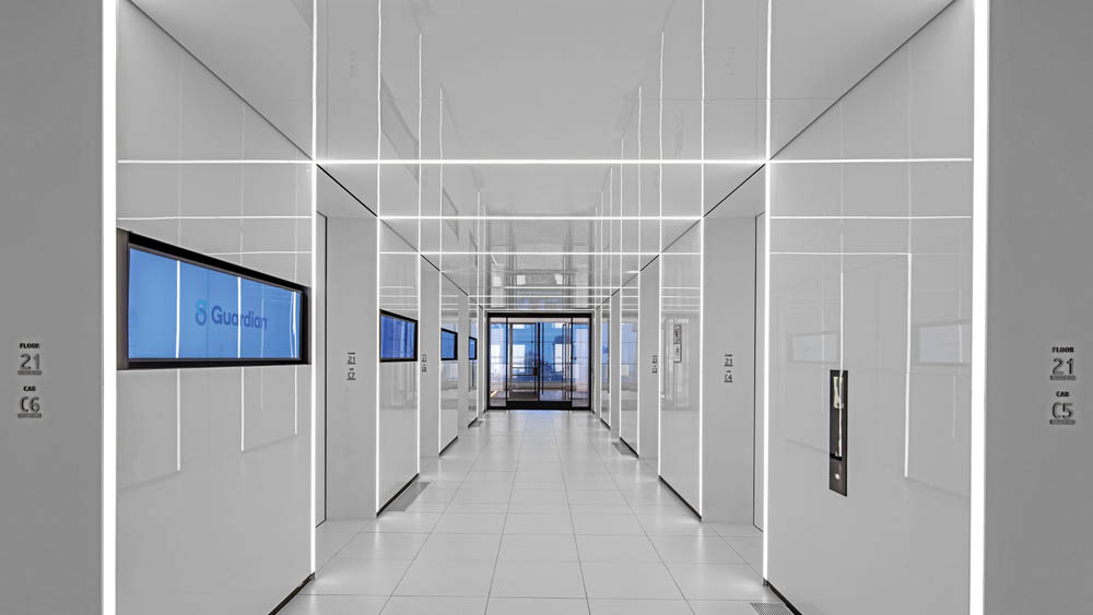 Custom Aluminum Portals + Back Painted Glass Lobby.