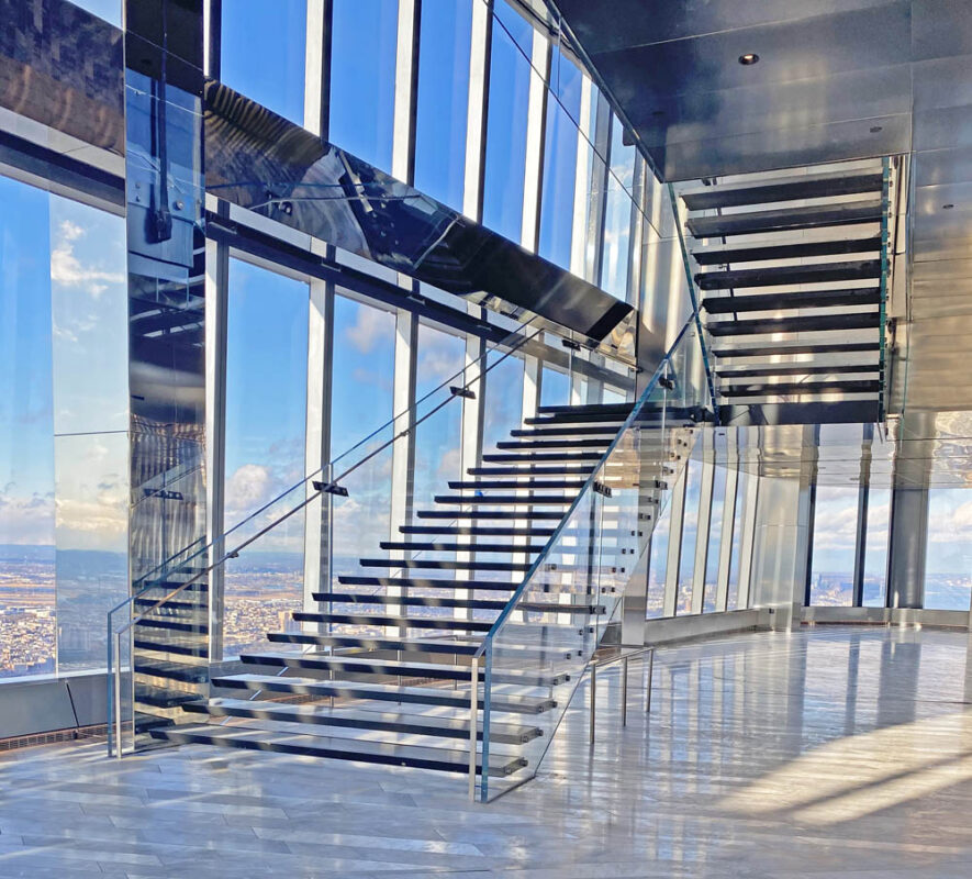 Design-build Structural Glass Guardrail With Floating Stainless Steel Treads.