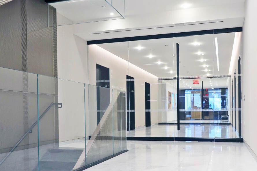 Custom Glass Entrance + Elevator Door Jambs.