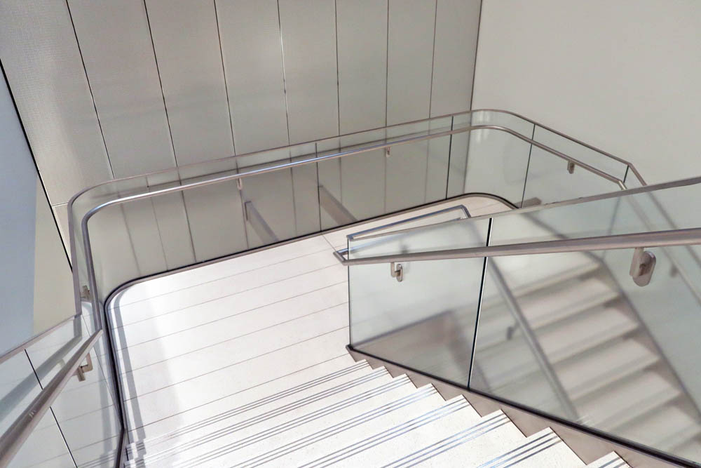 Design-build Stainless Steel Stringers, Acid Etched Laminated Glass + Non-bolt-through Brackets.