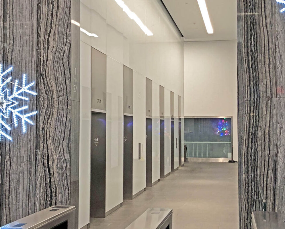 Stainless Steel Elevator Jambs + Back Painted Glass.