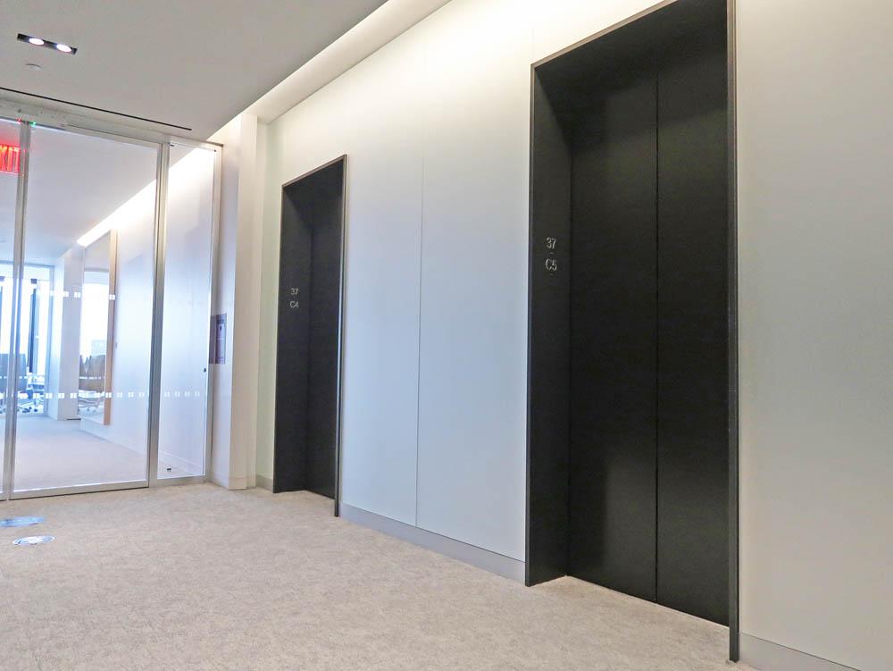 Blackened Steel Elevator Jambs + Entrances.