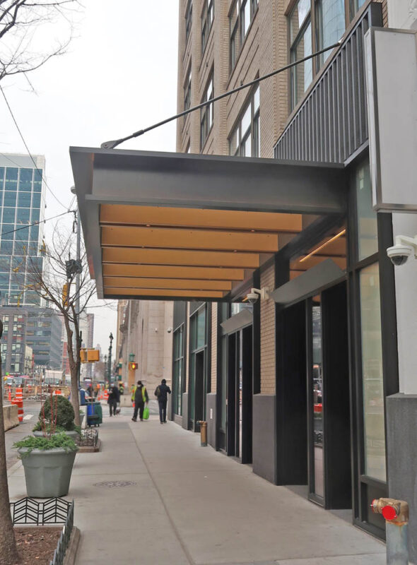 Custom Storefront System With Corrugated Metal Cladding + Canopy.